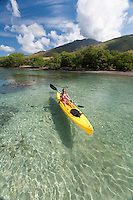 A woman kayaks at Olowalu, Maui.
