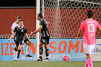 Sonia Bompastor (8) of the Washington Freedom celebrates scoring with teammate Abby Wambach (20). Sky Blue FC and the Washington Freedom played to a 1-1 tie during a Women's Professional Soccer (WPS) match at Yurcak Field in Piscataway, NJ, on August 11, 2010.