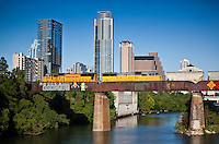 Union Pacific Train runs over Lady Bird Lake with Austin Skyline