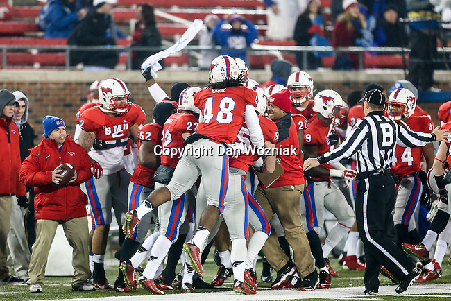 Southern Methodist Mustangs linebacker Anthony Rhone (48) and other SMU players in action during the game between the South Florida Bulls and the SMU Mustangs at the Gerald J. Ford Stadium in Fort Worth, Texas. SMU leads USF 13 to 0 at halftime.