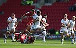 Guiness Pro12<br /> Ulster lock Franco Van Der Merwe skips through the diving tackle of Scarlets hooker Ken Owens<br /> Scarlets v Ulster<br /> Parc y Scarlets<br /> <br /> 06.09.14<br /> ©Steve Pope-SPORTINGWALES