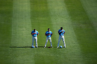 Spokane Indians outfielders Tanner Gardner (44), Julio Pablo Martinez (27), and Starling Joseph (39) stand for the national anthem before a Northwest League game against the Vancouver Canadians at Avista Stadium on September 2, 2018 in Spokane, Washington. The Spokane Indians defeated the Vancouver Canadians by a score of 3-1. (Zachary Lucy/Four Seam Images)