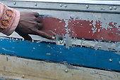 Mato Grosso State, Brazil. Aldeia Metuktire. Showing a bullet hole in a boat owned by the Kayapo community, following a shooting by a rancher.