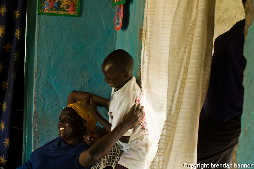 Clinton and his grandmother Hellen. Clinton has  been recieving medical care for HIV  since 2003. He has yet to begin  ARVs.  His parents died within six months of each other from AIDS. They refused to be tested and never sought treatment.