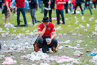 Thursday  16 June 2016<br /> Pictured: A wales fan looks dejected as his sits amongst the rubbish at the Wales fan zone Cardiff<br /> Re: Wales Fans at the fanzone in Cardiff, Wales UK