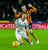 Hull City's midfielder Jackson Irvine (4) fouls Sheffield United's defender Enda Stevens (3) during the Sky Bet Championship match between Hull City and Sheff United at the KC Stadium, Kingston upon Hull, England on 23 February 2018. Photo by Stephen Buckley / PRiME Media Images.