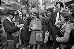 Strutton Ground Street Market, Victoria  London 1970s. Market trader selling his goods. Drawing in a crowd of lunch time shoppers 1976 UK