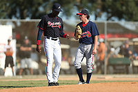 Coach Fred McGriff (27) talks with pitcher Peyton Glavine (18) during the WWBA World Championship at the Roger Dean Complex on October 21, 2016 in Jupiter, Florida.  pitcher Peyton Glavine (18).  (Greg Wagner/Four Seam Images)