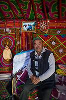 Mongolia, Bayan-Ulgii, Ulgii, Altai Mountains. Kazakh man in his yurt.