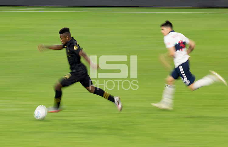 LOS ANGELES, CA - SEPTEMBER 23: Jose Cifuentes #11 of the Los Angeles football club of LAFC dribbles the ball during a game between Vancouver Whitecaps and Los Angeles FC at Banc of California Stadium on September 23, 2020 in Los Angeles, California.