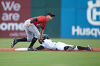 Jacob May (8) of the Charlotte Knights is tagged out by Kevin Kramer (17) of the Indianapolis Indians as he tries to steal second base at BB&T BallPark on August 22, 2018 in Charlotte, North Carolina.  The Indians defeated the Knights 6-4 in 11 innings.  (Brian Westerholt/Four Seam Images)