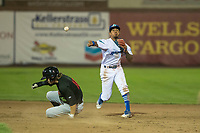 Ogden Raptors second baseman Kenneth Betancourt (9) throws to first base on a double play attempt as Travis Moniot (16) slides into second base during a Pioneer League game against the Great Falls Voyagers at Lindquist Field on August 23, 2018 in Ogden, Utah. The Ogden Raptors defeated the Great Falls Voyagers by a score of 8-7. (Zachary Lucy/Four Seam Images)