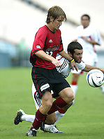26 June 2004:   Dallas Burn Philip Salyer fights for the ball against DC United Midfielder Ben Olsen at Cotton Bowl in Dallas, Texas.   DC United and Dallas Burn are tied 1-1 after the game.   Credit: Michael Pimentel / ISI