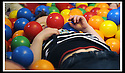 03/05/2009  Copyright  Pic : James Stewart.07_the_buzz.**** FREE FIRST USE WHEN USED IN RELATION TO  OPENING OF THE BUZZ ****.THE UK'S LARGEST SOFT PLAY AND LASER QUEST ARENA OPENS IN FALKIRK...... .LOGAN RUSSELL (3) TIRES HIMSELF OUT AS HE HAS FUN IN THE BALL PIT....For more information contact Jonathan Kennedy or Alison Jack at Wave PR on 0141 303 8390 / 07803 137262..James Stewart Photography 19 Carronlea Drive, Falkirk. FK2 8DN      Vat Reg No. 607 6932 25.Telephone      : +44 (0)1324 570291 .Mobile              : +44 (0)7721 416997.E-mail  :  jim@jspa.co.uk.If you require further information then contact Jim Stewart on any of the numbers above.........