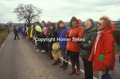 """Aldermaston to Greenham Common Easter 1983. Peace demonstrators formed a human chain stretching 14 miles. They lined a route along what the protesters call """"Nuclear Valley"""" in Berkshire. The chain started at the American airbase at Greenham Common, passed the Aldermaston nuclear research centre and ended at the ordnance factory in Burghfield."""