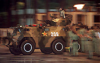 01.07.96 : HONG KONG : PLA : BORDER CROSSING<br /> CHINESE ARMORED PERSONNEL CARRIER CROSSES HK BORDER IN HEAVY RAIN AT LOK MA CHAU CHECKPOINT, 6AM. APPROX 4,000 TROOPS AND 417 VEHICLES PASSES INTO HK DURING THE DAWN TROOP MOVEMENTS