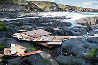 "Friday  29 April 2016<br /> Pictured: Parts of the boat have been washed up on the score at Abereiddi <br /> Re: Two fishermen who went missing after a boat sank in Pembrokeshire went overboard while lobster pots were being thrown into the sea.<br /> Gareth Willington, 59, from Carew, died after his boat The Harvester sank off St David's Head on 28 April.<br /> The body of his son, Daniel, 32, has never been found.<br /> Gareth Willington was not wearing a lifejacket when he was found, a report by the Marine Accident Investigation Branch said.<br /> The investigation found the pair were lobster fishing near Ramsay Island when Daniel Willington may have become entangled in ropes on the deck.<br /> His father may have tried to help him before both men went into the water ""in quick succession"", it said."