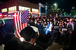NYPD officers create a path through a crowd of protesters to clear traffic in the Orthodox Jewish neighborhood Borough Park on Wednesday, October 7, 2020 in the Park in the Brooklyn borough of New York City.  Residents are protesting against new restrictions that would close schools, limit attendance at religious services and close non-essential businesses in areas with surges in COVID-19 cases.  Photograph by Michael Nagle