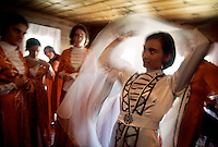 Circassian dancers prepare for Yayla ceremony.....TurkeyÕs Black Sea coast has the highest peaks close to a sea anywhere in the world. ....The migration from summer fishing to highland shepherding has always been a part of the culture.  Mountain homes are called Yaylas (YIY-luz), and most families have more than one.  Families fish at the coast, but as the temperatures rise, they move to a succession of homes higher in the mountain range.  These homes are community property and were bequeathed during the Ottoman period. ....Evidence shows that after the ice age, the Bosporus channel was the last to give way to the rising ocean and the Black Sea was the last to fill.  When the water flooded in, Neolithic people ran as much as two miles a day for over a year.  Today's residents are desendants of the people who ran away from the great flood. This bit of history burns in our collective memory still as NoahÕs flood or the flood from the epic of Gilgamesh...