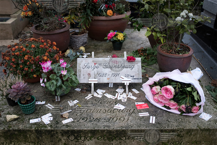 Flowers on the grave of Serge Gainsbourg in the Montparnasse Cemetery.