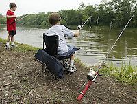 Dakota Howell (9), right, and his brother John (7), of Springfield, fish from the bank of the lake during a fishing derby Saturday, June 11, 2005, in Bellbrook, Ohio.