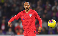 ORLANDO, FL - NOVEMBER 15: John Brooks #5 of the United States turns and moves with the ball during a game between Canada and USMNT at Exploria Stadium on November 15, 2019 in Orlando, Florida.