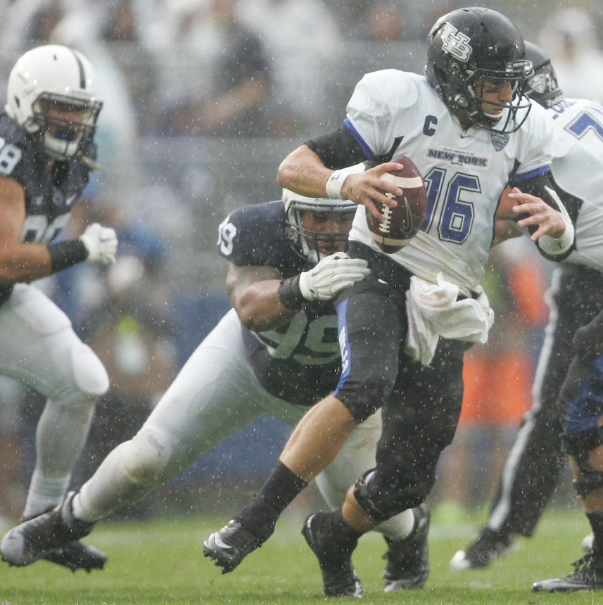 State College, PA - 09/12/2015:  Penn State DT Austin Johnson (99) sacks QB Joe Licata. Johnson had 9 total tackles during the game. Penn State defeated Buffalo by a score of 27-14 at rainy Beaver Stadium in University Park, PA.<br /> <br /> Photos by Joe Rokita / JoeRokita.com