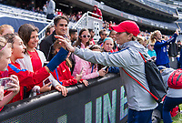 CHICAGO, IL - OCTOBER 5: Jill Ellis of the United States high fives a fan at Soldier Field on October 5, 2019 in Chicago, Illinois.