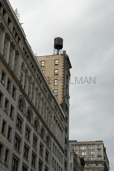 AVAILABLE FROM WWW.PLAINPICTURE.COM FOR LICENSING.  Please go to www.plainpicture.com and search for image # p5690260.<br /> <br /> Upward View of Buildings on 17th Street near Union Square Park with Wooden Watertower, New York City, New York State, USA