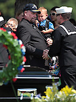 Randy Blunk, holding his grandson Maximus, 2, greets friends following the graveside service for his son Jonathan Blunk who was killed in the July 20 Colorado movie theater shooting. An estimated 500 people attended the memorial service in Reno, Nev. on Friday morning, Aug. 3, 2012. (AP Photo/Cathleen Allison)