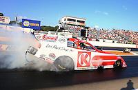Aug. 16, 2013; Brainerd, MN, USA: NHRA funny car driver Tim Wilkerson during qualifying for the Lucas Oil Nationals at Brainerd International Raceway. Mandatory Credit: Mark J. Rebilas-