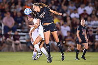 Texas midfielder Lindsey Meyer (4) lands on Texas State defender while attempting a  header during an NCAA soccer game, Sunday, September 21, 2014 in San Marcos, Tex. Texas defeated Texas State 2-0. (Mo Khursheed/TFV Media via AP Images)