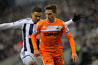 Pictured: Joe ALlen of Swansea (FRONT). Saturday, 04 February 2012<br /> Re: Premier League football, West Bromwich Albion v Swansea City FC v at the Hawthorns Stadium, Birmingham, West Midlands.