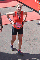 Sophie Raworth<br /> carried away by St John's Ambulance at the finish line on The Mall at the 2017 London Marathon, London. <br /> <br /> <br /> ©Ash Knotek  D3254  23/04/2017