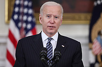 United States President Joe Biden makes remarks on the state of vaccinations in the State Dining Room of the White House in Washington, DC on Tuesday, April 6, 2021. Earlier, the President said he expects a significant portion of the population to be vaccinated by the end of the summer. <br /> CAP/MPI/RS<br /> ©RS/MPI/Capital Pictures