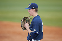 Wingate Bulldogs first baseman Mitch Farris (15) on defense against the Concord Mountain Lions at Ron Christopher Stadium on February 1, 2020 in Wingate, North Carolina. The Bulldogs defeated the Mountain Lions 8-0 in game one of a doubleheader. (Brian Westerholt/Four Seam Images)