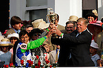 Jockey Edgar Prado (left) hold the trophy with owner Roy Jackson in the winners circle at Churchill Downs in Louisville, Kentucky on May 6, 2006.  Barbaro, ridden by Prado, won the race....