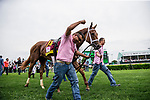 LOUISVILLE, KY - MAY 04: The groom of Monomoy Girl celebrates winning the  Longines Kentucky Oaks at Churchill Downs on May 4, 2018 in Louisville, Kentucky. (Photo by Alex Evers/Eclipse Sportswire/Getty Images)