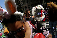 Richard J. Concepcion, a.k.a. Rapid T. Rabbit, walks through the crowd at the Easter Stroll in Manhattan, New York.   Furries are a group of people who identify themselves not as being human but as a walking, talking animal.  For some the lifestyle is complete, animal traits reach into every aspect of life from mundane trips to a grocery store to sexual fantasies.  For others, involvement in the furry fandom is limited to public performances and meet-and-greets.