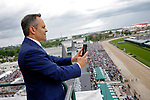 LOUISVILLE, KY - MAY 06: Kentucky Governor Matt Bevin takes a panoramic photo from the rooftop of Churchill Downs before the American Turf Stakes on Kentucky Derby Day on May 6, 2017 in Louisville, Kentucky. (Photo by Jon Durr/Eclipse Sportswire/Getty Images)