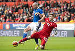 Aberdeen v St Johnstone…18.09.21  Pittodrie    SPFL<br />Chris Kane is tackled by David Bates<br />Picture by Graeme Hart.<br />Copyright Perthshire Picture Agency<br />Tel: 01738 623350  Mobile: 07990 594431