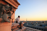 Paris, Opera Garnier. Jean Paucton, 76 years old, set up his hives twenty years ago on the roof of the Opera just by chance. A prop man at the opera, he took courses in beekeeping at the Société Centrale for apiculture in the Luxembourg gardens. Sharing his time between Paris and the Creuse, he didn't know what to do with a hive given to him by a friend. It was the Opera fireman, who himself bred fish in the underground pond beneath the opera, who gave him the idea of setting the bees up on the roof of the Garnier..