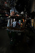Auto rickshaw driver, 20 year old Avdhesh Kumar poses for a portrait in his autorickshaw in New Delhi, India. Photo: Sanjit Das