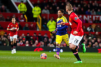 Sunday 05 January 2014<br /> Pictured:Jonathan de Guzman pushes the ball forwards<br /> Re: Manchester Utd FC v Swansea City FA cup third round match at Old Trafford, Manchester