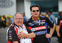 Mar. 9, 2012; Gainesville, FL, USA; NHRA team owners Connie Kalitta (left) and Bob Tasca during qualifying for the Gatornationals at Auto Plus Raceway at Gainesville. Mandatory Credit: Mark J. Rebilas-