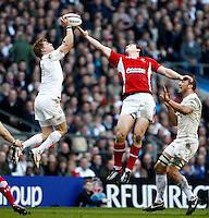 Photo: Richard Lane/Richard Lane Photography. England v Wales. 25/02/2012. England's David Strettle and Wales' George Roberts challenge for the ball.