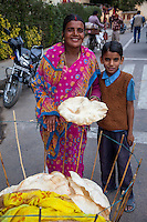 Jaipur, Rajasthan, India.  Woman and Son Selling Bread on the Street.