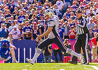 12 October 2014: New England Patriots punter Ryan Allen kicks on fourth down during a game against the Buffalo Bills at Ralph Wilson Stadium in Orchard Park, NY. The Patriots defeated the Bills 37-22 to move into first place in the AFC Eastern Division. Mandatory Credit: Ed Wolfstein Photo *** RAW (NEF) Image File Available ***