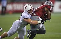 SEATTLE, WA - September 28, 2013: Stanford linebacker Jarek Lancaster tackles Washington State wide receiver Rickey Galvin during play at CenturyLink Field. Stanford won 55-17