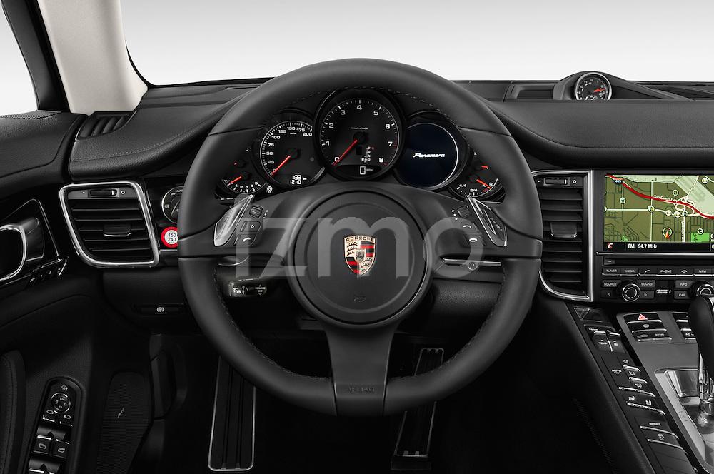 Car pictures of steering wheel view of a 2015 Porsche Panamera - 5 Door Hatchback 2WD Steering Wheel